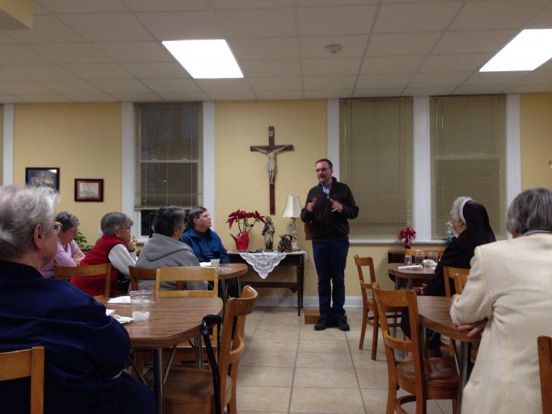 Father Eduardo speaking to the sisters