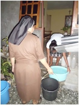 Sisters in Timor-Leste saving rainwater.