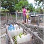Sisters fetching water from the well.