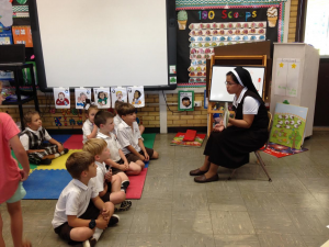 Sr. Cristilyn reading to students